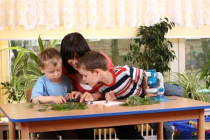 teacher together with her students having an experiment